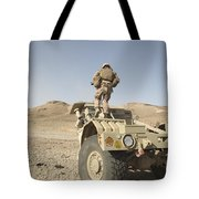 Soldier Climbs A Damaged Husky Tactical Tote Bag by Stocktrek Images