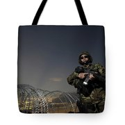 Soldier Patrols The Perimeter Of Camp Tote Bag