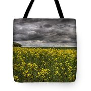 Summer Storm Clouds Over A Canola Field Tote Bag