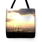 Sun Behind The Clouds On The Beach Tote Bag