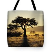 Sun Coming Up Behind A Tree In African Tote Bag