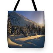 Sun Setting Behind Trees And Mountain Tote Bag