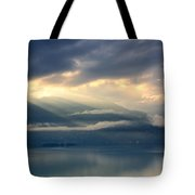 Sunlight And Clouds Over An Alpine Lake Tote Bag