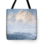 Sunrise Over A Snow-blanketed Landscape Tote Bag