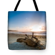 Sunset Over A Misty Beach Tote Bag
