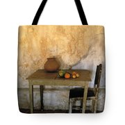 Table And Chairs Infront Of Weathered Tote Bag