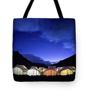 Tents Illuminated In A Valley At Night Tote Bag