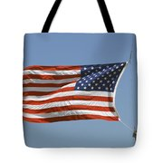 The American Flag Waves At Half-mast Tote Bag