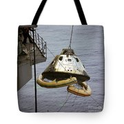 The Apollo 9 Command Module Is Hoisted Tote Bag