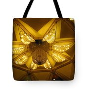 The Beautifully Lit Chandelier On The Ceiling Of The Iskcon Temple In Delhi Tote Bag