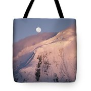 The Moon Rises Over Snow-blown Peaks Tote Bag