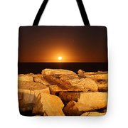 The Moon Rising Behind Rocks Lit Tote Bag