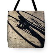 The Shadow That Follows Tote Bag