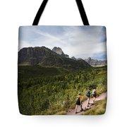Three Hikers Walk On A Trail Tote Bag