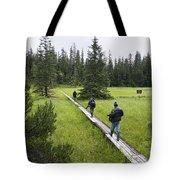 Tourists Walking On Boardwalk Tote Bag