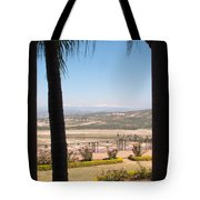 Tree Blocking View Of Garden And Valley And Ice-capped Mountains Tote Bag