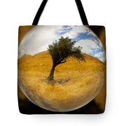 Tree In A Field Through A Glass Eye Tote Bag