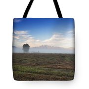 Tree With Fog On The Field Tote Bag