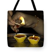Trying To Light An Oil Lamp That Has Gone Out Tote Bag