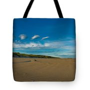 Twilight During A Sunset At A Beach With Beautiful Clouds Tote Bag