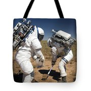Two Astronauts Collect Soil Samples Tote Bag by Stocktrek Images
