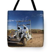 Two Astronauts Take A Ride On Scout Tote Bag