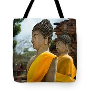 Two Buddha Statues Wrapped In An Orange Scarf  Tote Bag