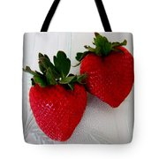 Two Strawberries On A Glass Plate Tote Bag