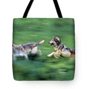 Two Wolves Running Through Meadow Tote Bag