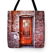 Urban Door In Old Brick Building Tote Bag