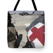 U.s. Army Crew Chief Inspects Tote Bag