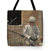 U.s. Army Soldier Configures Tote Bag