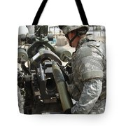 U.s. Army Soldier Loads A 105mm Tote Bag