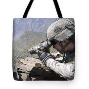U.s. Army Soldier Monitors An Afghan Tote Bag