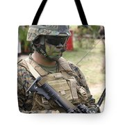 U.s. Marine Communicates Via Radio Tote Bag
