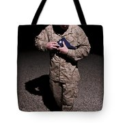 U.s. Marine Holding The American Flag Tote Bag