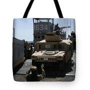 U.s. Marines Load An M1114 Humvee Onto Tote Bag