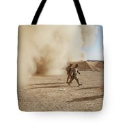U.s. Marines Walk Away From A Dust Tote Bag