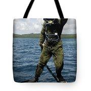 U.s. Navy Diver Jumps Off A Dive Tote Bag