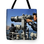 U.s. Navy Sailors Observe The Coastline Tote Bag