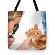 Vet Examining Kitten Tote Bag
