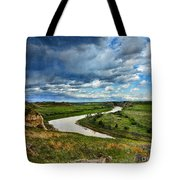 View Of River With Storm Clouds Tote Bag