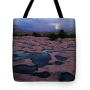 Water Puddled In The Esplanade, A Rock Tote Bag