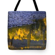 Water Reflections With A Rocky Shoreline Tote Bag