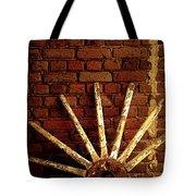 Wheel Against Wall Tote Bag