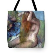 Woman Doing Her Hair Tote Bag