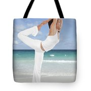 Woman Doing Yoga On The Beach Tote Bag