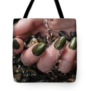 Woman Hand With Fancy Nail Polish In Water Tote Bag