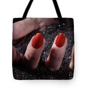 Woman Hand With Red Nail Polish Buried In Black Sand Tote Bag
