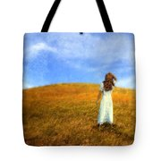 Woman In Field Looking Up At An Airplane Tote Bag
